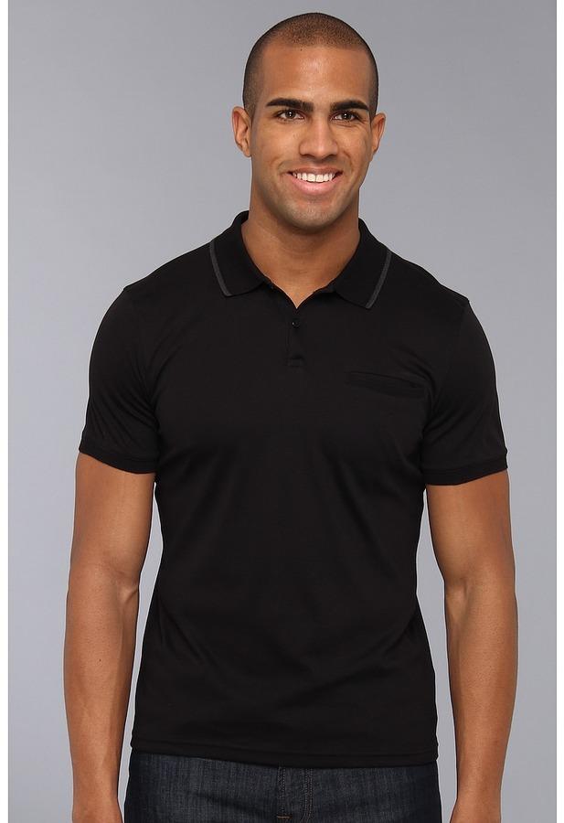 4159ec1beca Camisa polo negra de Calvin Klein  dónde comprar y cómo combinar