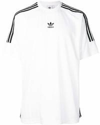 Camiseta con cuello circular de rayas horizontales en blanco y negro de adidas
