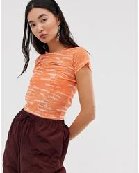 Camiseta con cuello circular efecto teñido anudado naranja de ASOS DESIGN