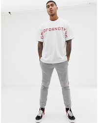 Camiseta con cuello circular estampada en blanco y rojo de Good For Nothing