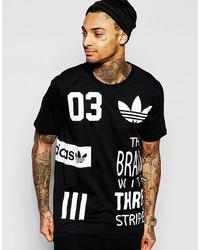 Camiseta con cuello circular estampada en negro y blanco de adidas