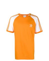 Camiseta con cuello circular estampada naranja de adidas
