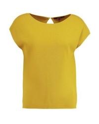 Camiseta con cuello circular mostaza de someday.