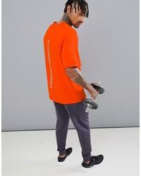 Camiseta con cuello circular naranja de Calvin Klein Performance
