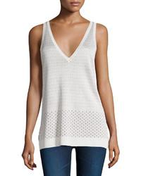 Camiseta sin manga a lunares blanca