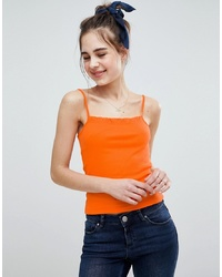 Camiseta sin manga naranja de ASOS DESIGN