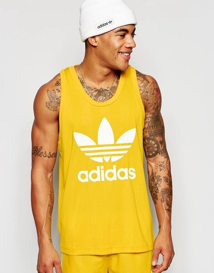 b9de049cef5e3 ... Camiseta sin mangas amarilla de adidas ...