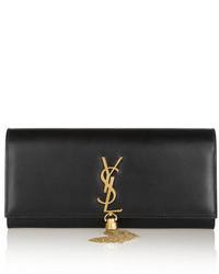 Cartera sobre de cuero en negro y dorado de Saint Laurent