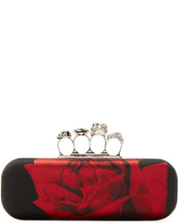 Cartera sobre en rojo y negro de Alexander McQueen