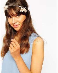Cinta para la cabeza con print de flores blanca de Orelia