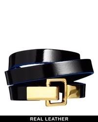 Cinturón de cuero en negro y dorado de Asos