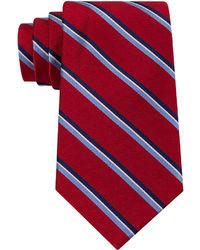 Corbata de rayas verticales en blanco y rojo y azul marino