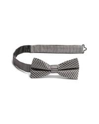 Corbatín de rayas verticales en negro y blanco