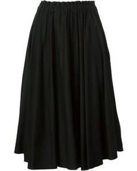 Falda midi plisada negra de Comme des Garcons