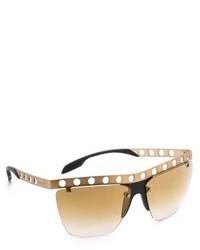 Gafas de sol en marrón y dorado de Prada