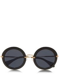 Gafas de sol en negro y dorado de Miu Miu