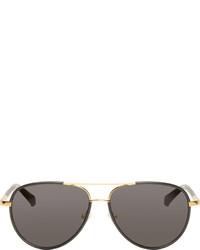 Gafas de sol en negro y dorado de The Row