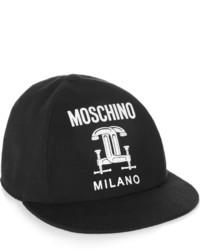 Gorra inglesa en negro y blanco de Moschino