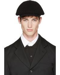 Gorra inglesa negra de Comme des Garcons