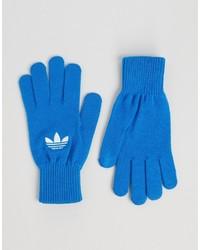 Guantes azules de adidas