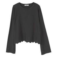 Jersey con cuello circular de rayas verticales negro de Mango