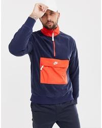 Jersey de cuello alto con cremallera en rojo y azul marino de Nike