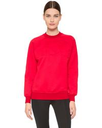 Jersey oversized rojo de Versace