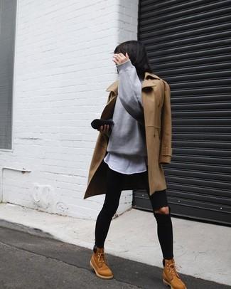31f9f924e4 Cómo combinar un abrigo marrón claro con unas botas planas con ...