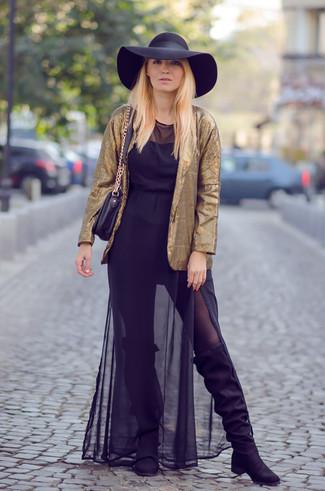 Vestido largo negro con botas