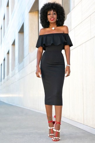 Vestido negro con zapatillas rojas