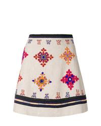 Minifalda bordada en beige de Wandering