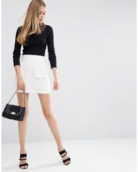 Minifalda con volante blanca