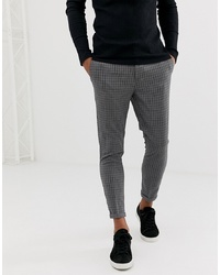 Pantalón chino a cuadros en gris oscuro de New Look