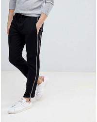 Pantalón chino en negro y blanco de Mango