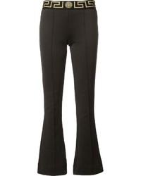 Pantalón de campana estampado negro de Versace