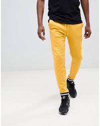 Pantalón de chándal amarillo de ASOS DESIGN