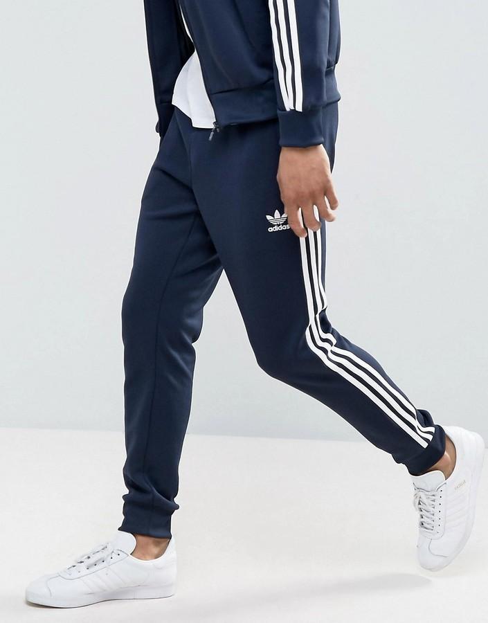 dc59ee5d01289 ... Pantalón de chándal azul marino de adidas ...