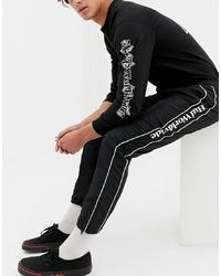 Pantalón de chándal de rayas verticales en negro y blanco de HUF