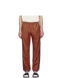 Pantalón de chándal de rayas verticales rojo de Gucci