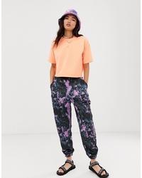 Pantalón de chándal efecto teñido anudado en multicolor de ASOS DESIGN