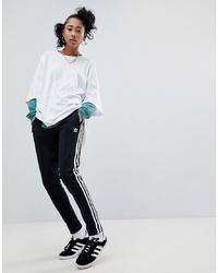 Pantalón de chándal en negro y blanco de adidas Originals