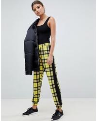 Pantalón de chándal estampado amarillo de ASOS DESIGN