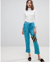 Pantalón de pinzas con print de flores azul de Vero Moda