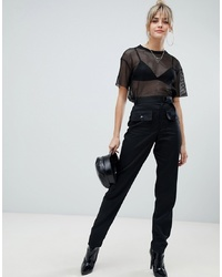 Pantalón de pinzas negro de PrettyLittleThing