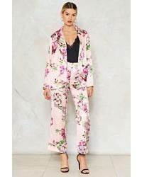 Pantalón de vestir de satén con print de flores rosado