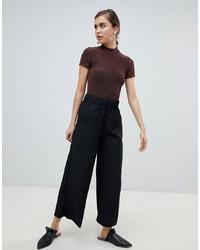 Pantalones anchos a lunares negros de Monki