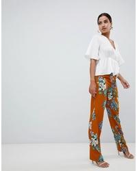 Pantalones anchos con print de flores naranjas de Missguided