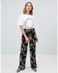 Pantalones anchos con print de flores negros de Gestuz