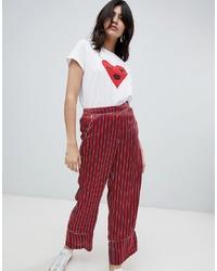 Pantalones anchos de rayas verticales rojos de Soaked in Luxury