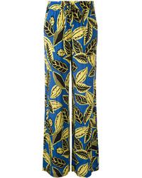Pantalones anchos estampados azules de Moschino